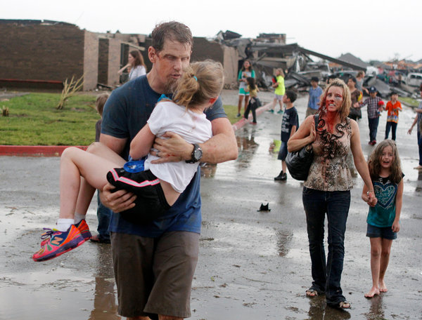Children were carried away from Briarwood Elementary School after a tornado destroyed the school in south Oklahoma City on Monday.